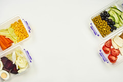 Lunchboxes with dieting meal on two sides and copy space in the middle