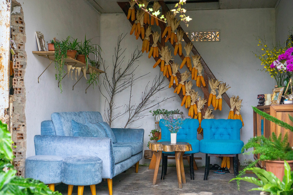Cozy Cafe Space with Sofa and Couch Chairs and Corn on the Cob as Decoration