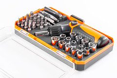 Specialized screwdriver with bits set in box
