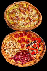 Two round delicious Italian pizza on a black background