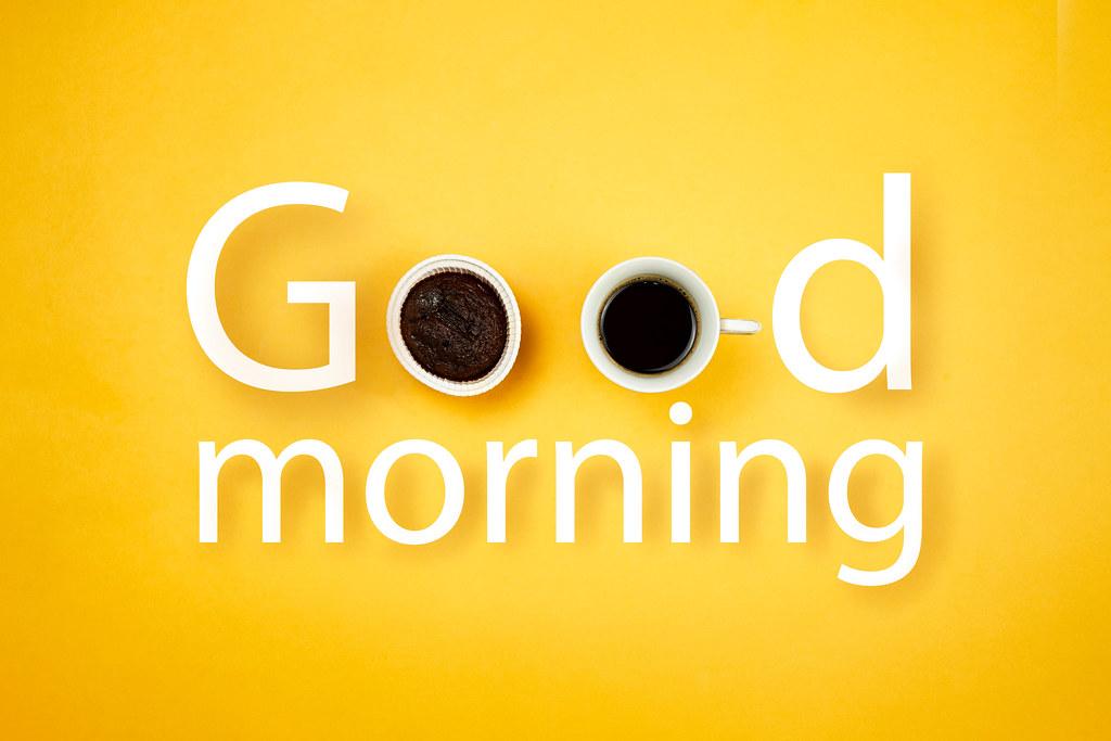 Good morning inscription made with sweet cake and coffee mug