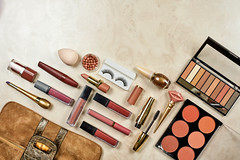 Beautiful flat-lay arrangement of beauty products and make-up tools