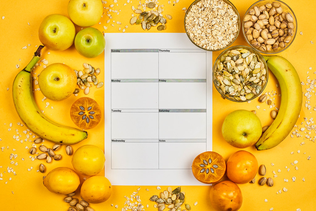 Healthy eating plan. Diet schedule with fresh organic vegetables, fruit and seeds