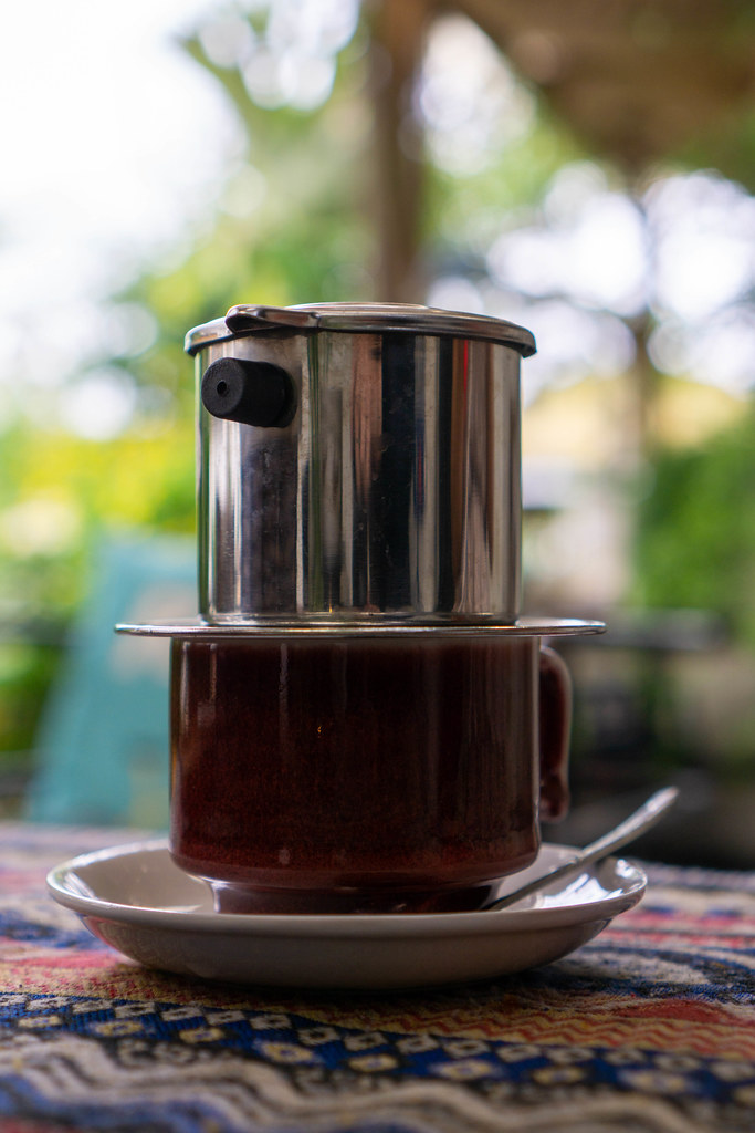 Close Up of Ceramic Cup with Vietnamese Coffee Filter on Top