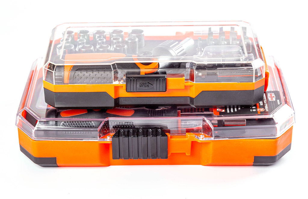Two boxes with tools on a white background