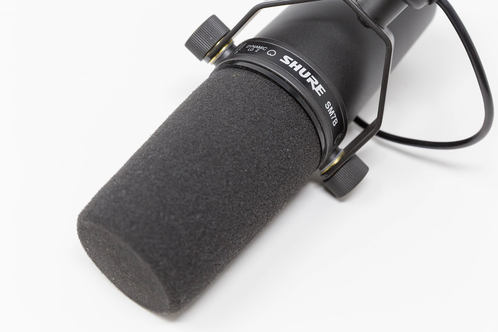 Close-up of Shure SM7B microphone in front of white background