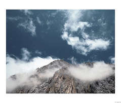 Clouds kiss the top of the mountain.