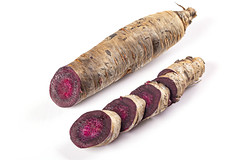 Purple fresh carrots, cut into round pieces
