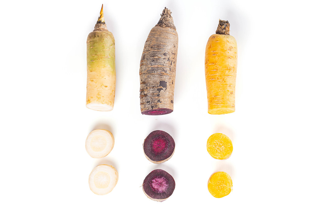 White, purple and yellow carrots, sliced