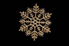 Golden Christmas snowflake on black background