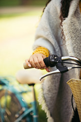 Close up of a woman's hand on a bicycle handle.