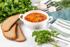 Russian borsch with garlic, fresh parsley and slices of black bread