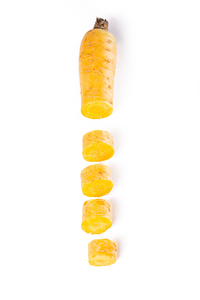 Pieces of bright fresh yellow carrot