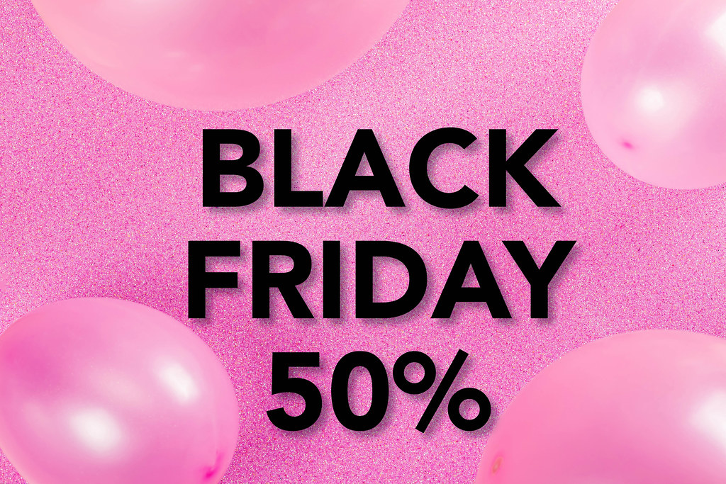 Black Friday sale concept on pink background with balloons