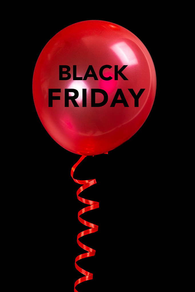 Red balloon on black background, black friday concept