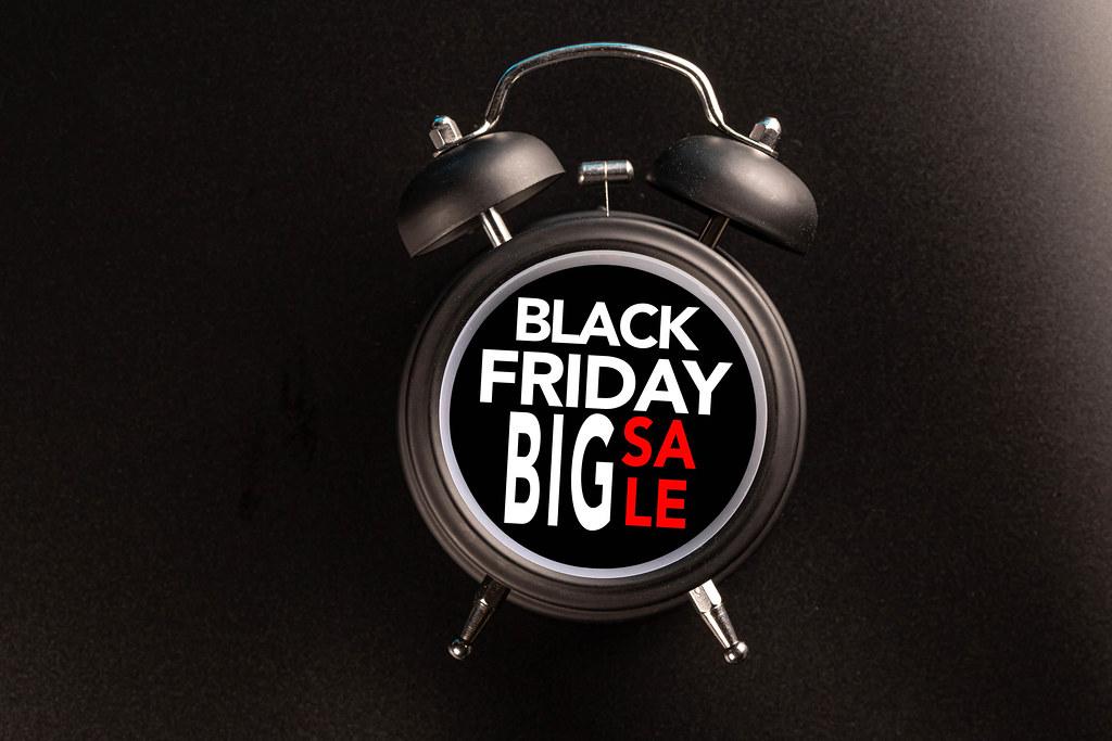 Black Friday text on black alarm clock, sale concept