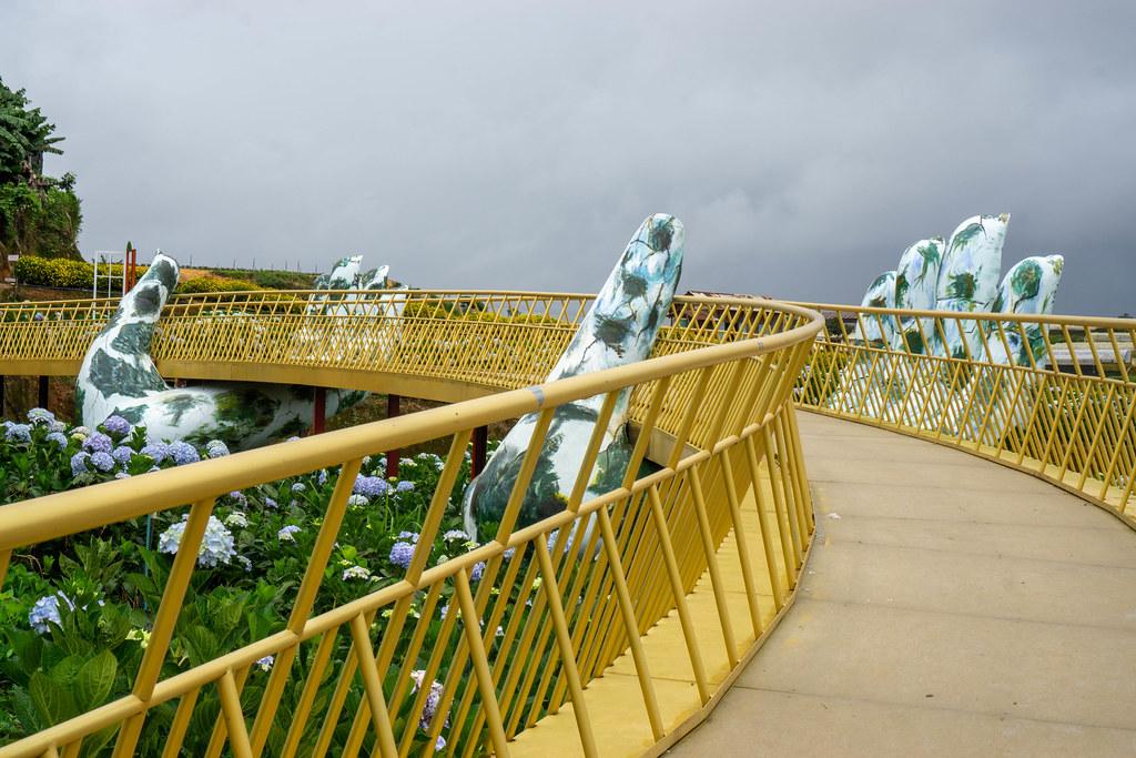 Golden Bridge with Giant Hands as Copy at Hydrangea Flower Garden in Da Lat, Vietnam