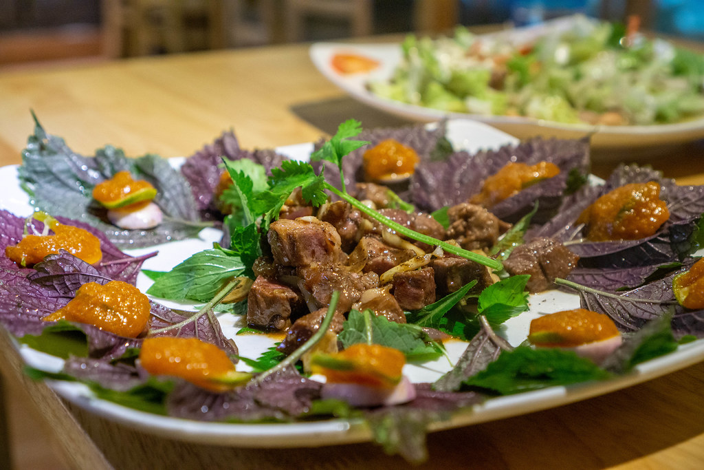 Close Up of Vietnamese Wrap and Roll Dish with Stir Fried Beef, Herbs and Kumquat Sauce