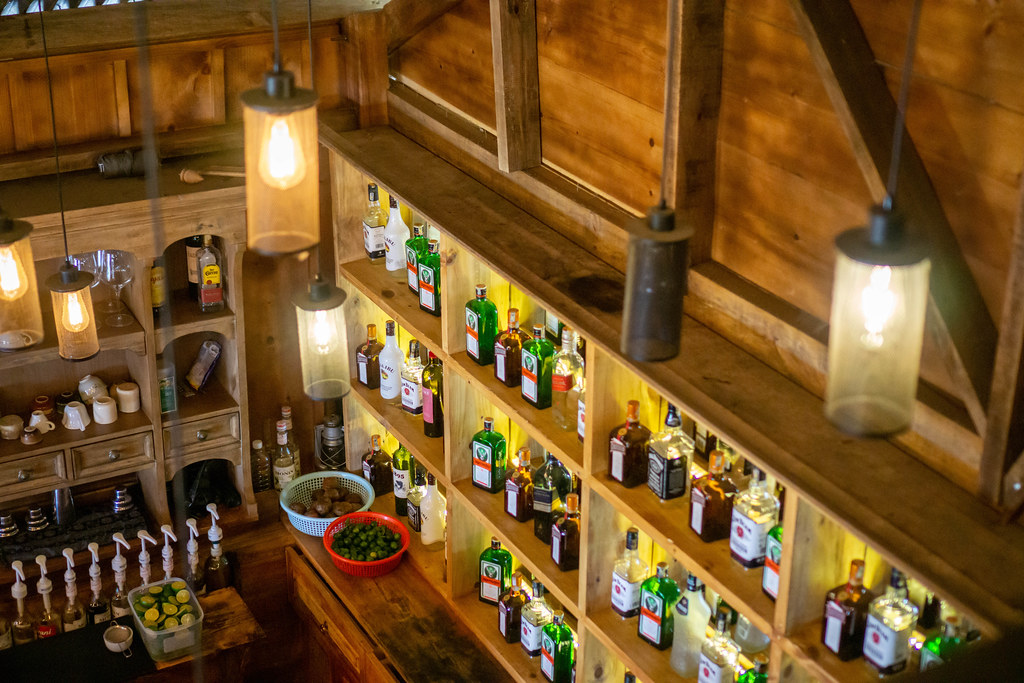 Wooden Bar with many kinds of Liquor, Syrup and other Ingredients for Cocktails