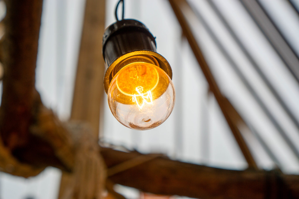 Bokeh Photo of Hanging Light Bulb with Glowing Electric Wire
