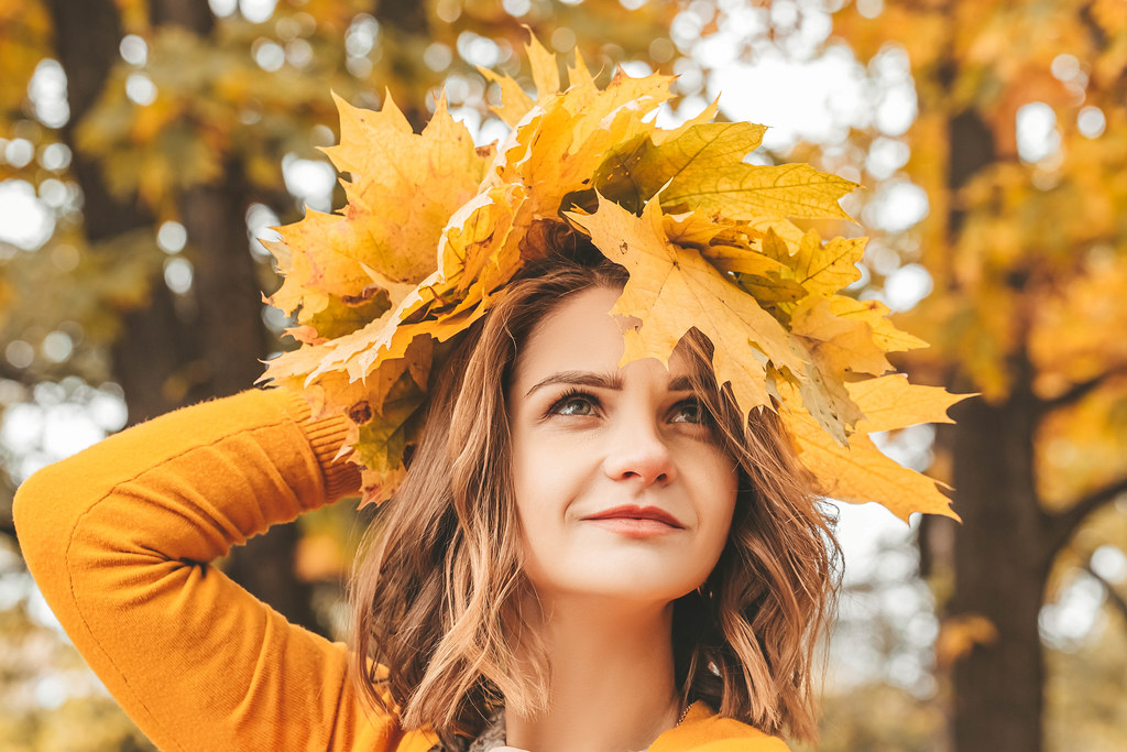 Close-up, woman wearing a wreath of autumn leaves