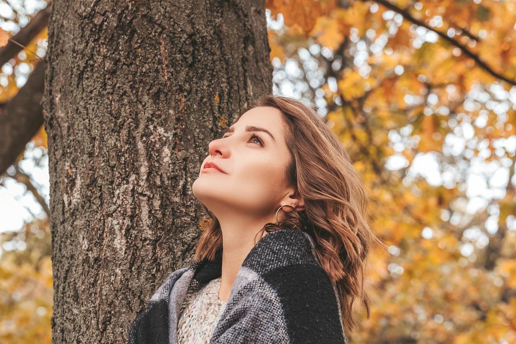 Romantic girl in autumn landscape