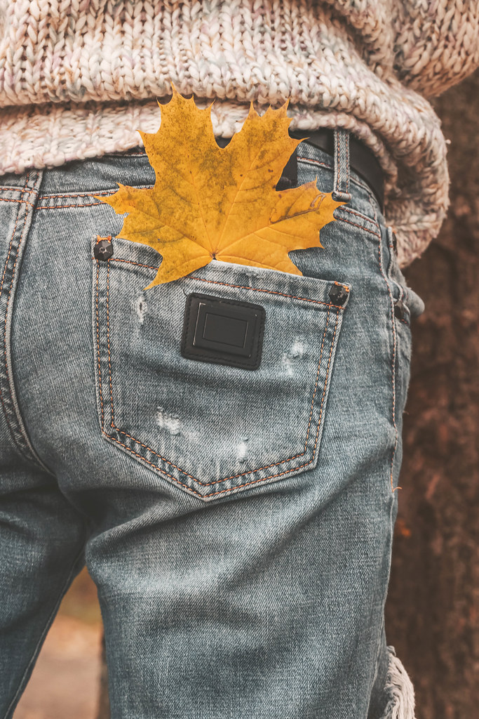 Maple leaf in the pocket of women's jeans