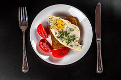 Top view, toast bread with egg and tomato slices