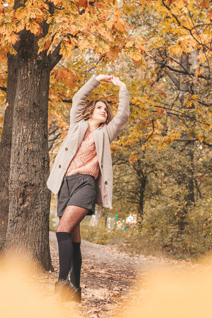 Beautiful model posing in autumn forest