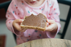 Delicious hazelnut spread on  a piece of bread.