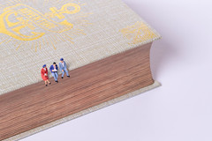 Group of people sitting on old book