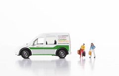 Two woman with bag and delivery van on white background