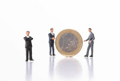 Group of businessman with 1 Euro coin on white background