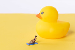Woman in bathing suit with yellow rubber duck