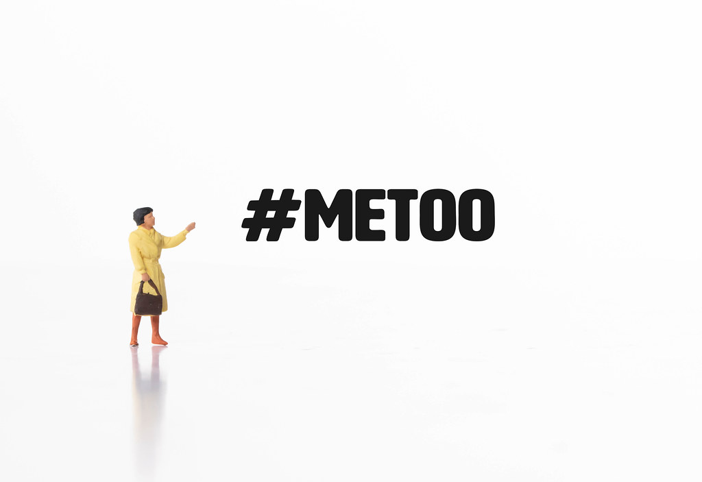 Woman pointing at #MeToo text