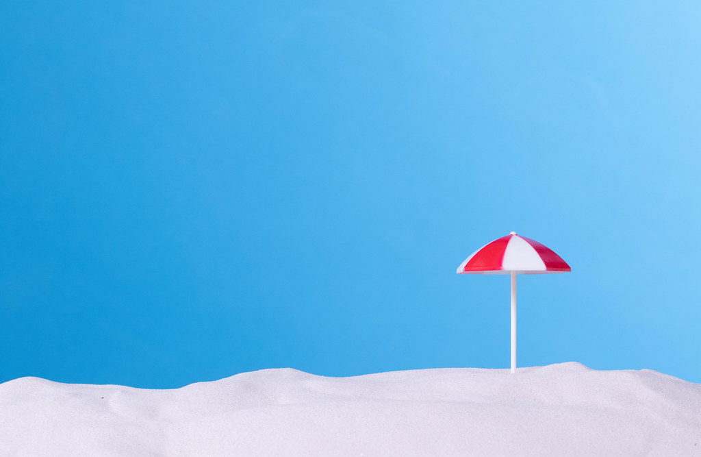 Beach umbrella with blue background