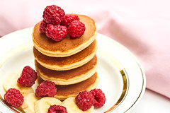 Stack of pancakes with berries on a plate