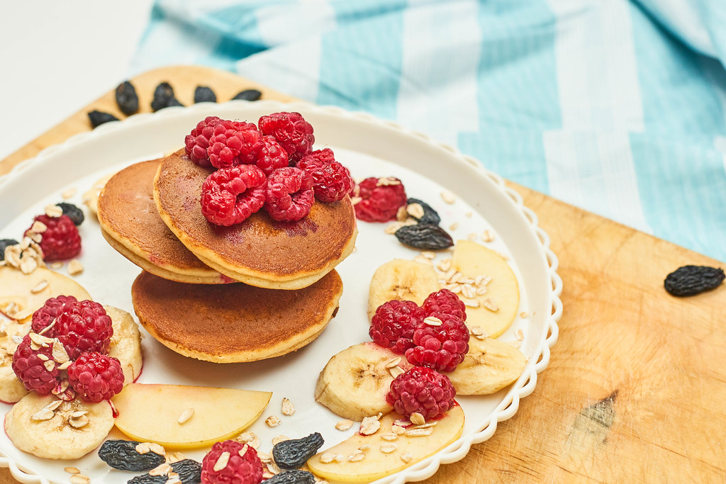 Sweet pancakes with delicious berries and banana slices