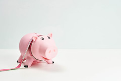 Piggy bank and measuring tape - Dieting concept