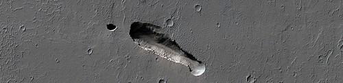 Mars - Elongated Collapse Pit in Ceraunius Fossae