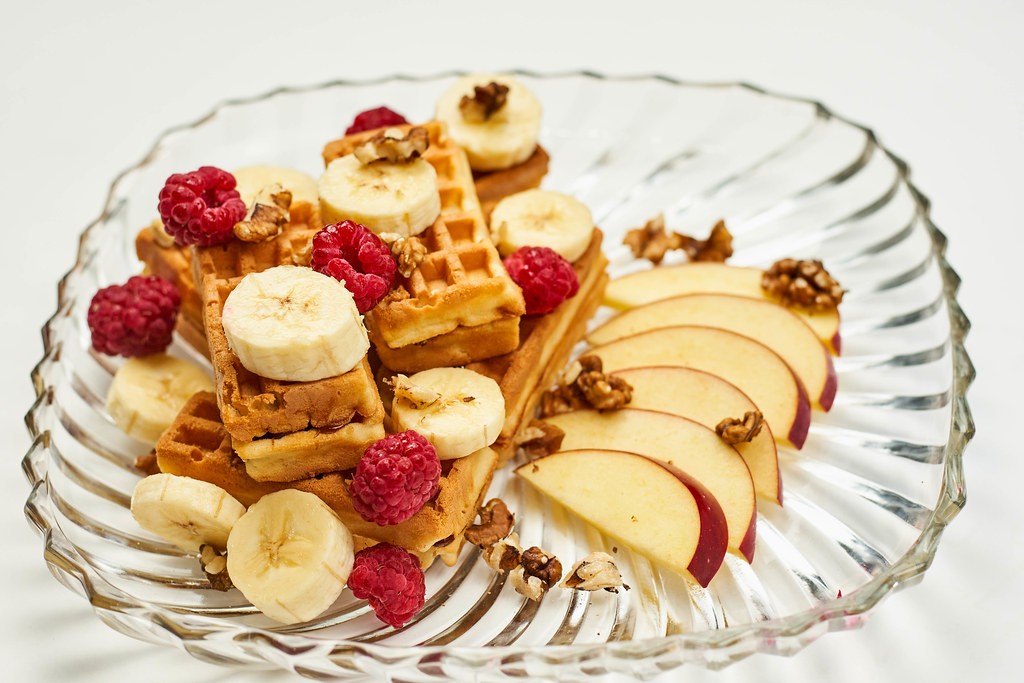 Sweet breakfast with fresh fruits and waffles