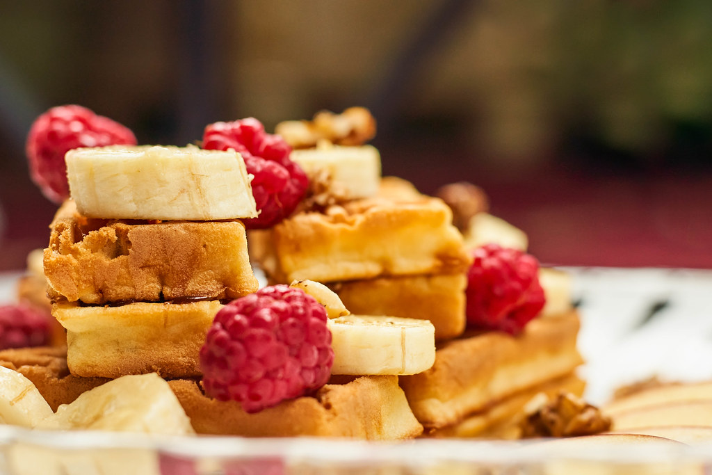 Freshly baked waffles with raspberries and bananas