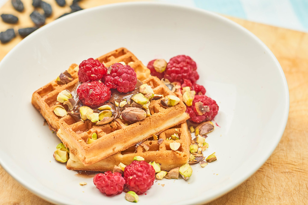 Close-up view of Belgian breakfast with waffles and fruits