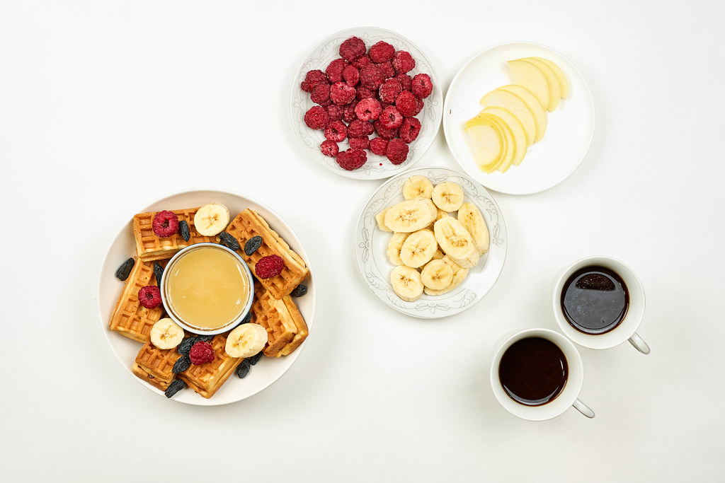 Delicious breakfast with fruits and sweet desserts for two persons