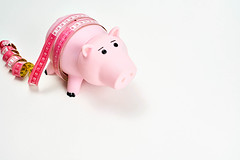 Piggy bank with measurement tape - Concept of economy and money diet