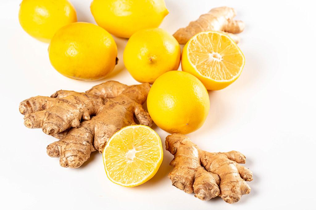 Fresh ginger roots with ripe lemons