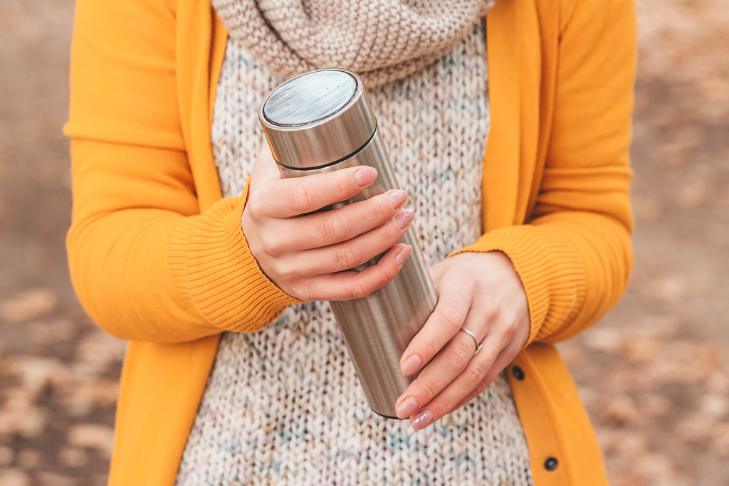 Close-up, thermos in women's hands