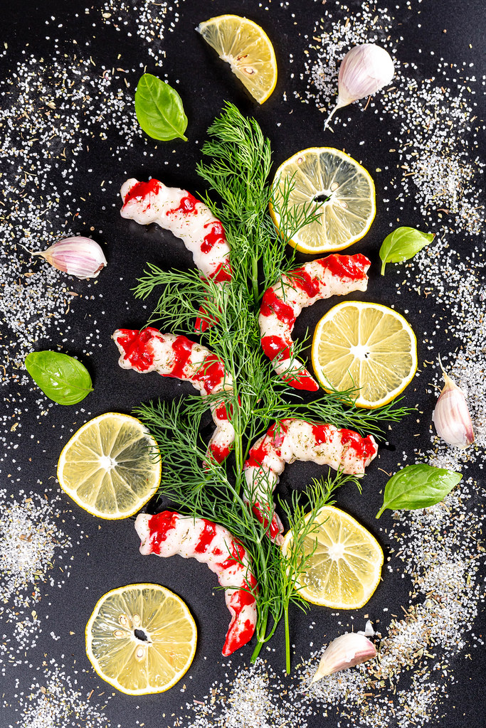 Delicious and healthy seafood concept-shrimp and spices, top view