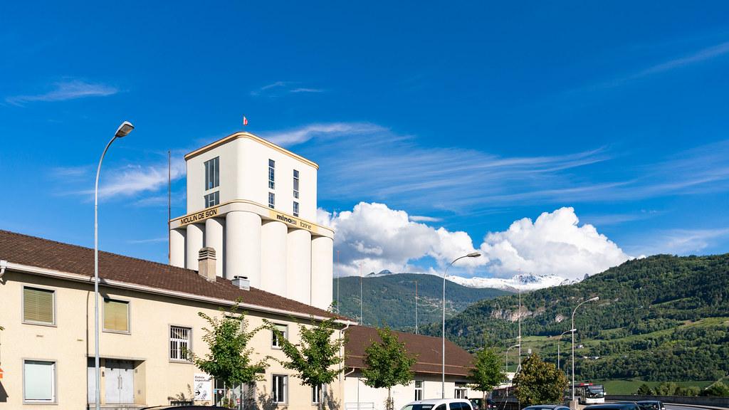 Moulin de Sion building with mountainous backdrop