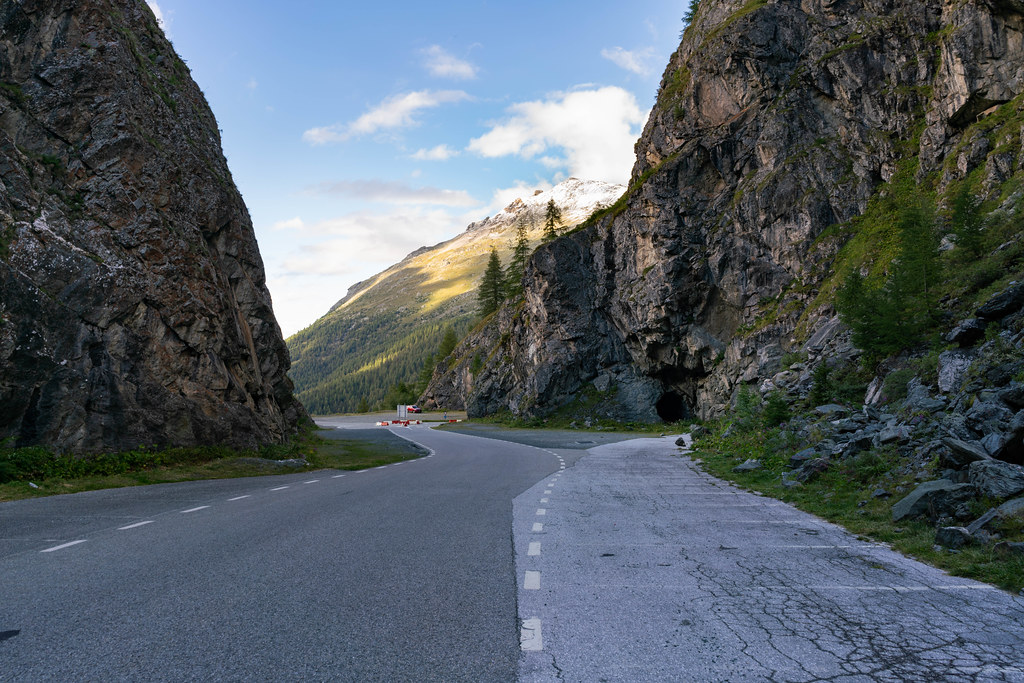 Picturesque Swiss road between cliffs leading to the tunnel